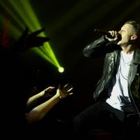 Photo - Musician Macklemore performs during a concert presented by T-Mobile at The Belasco Theatre, Thursday, Jan. 23, 2014 in Los Angeles. (Photo by Matt Sayles/Invision/AP)