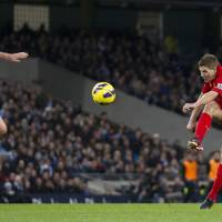 Photo - Liverpool's Steven Gerrard, right, scores past Manchester City's Gareth Barry during their English Premier League soccer match at The Etihad Stadium, Manchester, England, Sunday Feb. 3, 2013. (AP Photo/Jon Super)