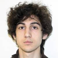 Photo - This photo released Friday, April 19, 2013 by the Federal Bureau of Investigation shows a suspect that officials identified as Dzhokhar Tsarnaev, being sought by police in the Boston Marathon bombings Monday.  (AP Photo/Federal Bureau of Investigation)