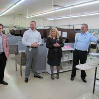 Photo - Yolanda Olivarez, regional administrator for the Small Business Administration, tours Chickasha's HSI Sensing Inc. with owners Ryan Posey, from left, Travis Posey and David Posey. PHOTO PROVIDED