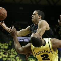 Photo - Baylor's Rico Gathers (2) takes a charge to the basket by Kansas State's Angel Rodriguez in the first half of an NCAA college basketball game on Saturday, March 2, 2013, in Waco, Texas. (AP Photo/Tony Gutierrez)