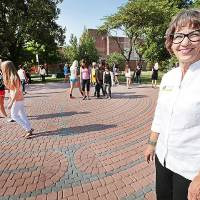 Photo - UNIVERSITY OF CENTRAL OKLAHOMA: Diane Rudebock, a professor in UCO's Department of Kinesiology and Health Studies, with a group of her students out on UCO's new labyrinth, Thursday , August 22, 2013. Photo by David McDaniel, The Oklahoman