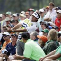 Photo - Bubba Watson watches his shot out of the gallery on the 18th hole during the second round of the Masters golf tournament Friday, April 11, 2014, in Augusta, Ga. (AP Photo/Darron Cummings)