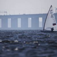 Photo - Poland's Finn class Piotr Kula competes during the first test event for the Rio 2016 Olympic Games at the Guanabara Bay in Rio de Janeiro, Sunday, Aug. 3, 2014. American sailing officials have hired medical experts to test the water in Guanabara, which has suffered from decades of untreated human waste being poured into the bay. (AP Photo/Felipe Dana)