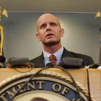 Photo -   In this July 27, 2005 photo, FBI Agent Frederick Humphries speaks during a news conference after the sentencing of Ahmed Ressam at the Federal Courthouse in Seattle. Humphries has been identified as the agent socialite Jill Kelley contacted to complain about harassing emails sent by Gen. David Petraeus' paramour, Paula Broadwell. (AP Photo/Kevin P. Casey)