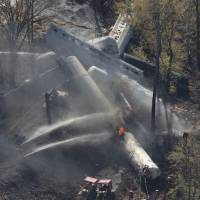 Photo -   Flames can be seen from the air after an explosion happened at the sight of a train derailment in southern Jefferson County, just south of Louisville, Ky, Wednesday, Oct. 31, 2012. (AP Photo/The Courier-Journal, Sam Upshaw)