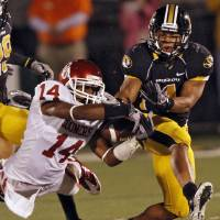 Photo - Oklahoma's Aaron Colvin (14) breaks up a pass for Missouri's Kendial Lawrence (4) last season. Photo by Chris Landsberger, The Oklahoman