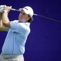 Photo - Phil Mickelson tees off on the first hole during the first round of the St. Jude Classic golf tournament Thursday, June 5, 2014, in Memphis, Tenn. (AP Photo/Mark Humphrey)