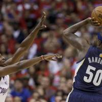 Photo - Memphis Grizzlies forward Zach Randolph shoots under pressure by Los Angeles Clippers forward Lamar Odom during the first half of Game 1 of a first-round NBA basketball playoff series Los Angeles, Saturday, April 20, 2013. (AP Photo/Chris Carlson)