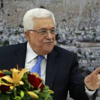 Photo - Palestinian President Mahmoud Abbas attends a meeting of the Palestinian leadership in the West Bank city of Ramallah, Thursday, July 18, 2013. Abbas convened a special gathering of top Palestinian officials for what could be a make-or-break decision on U.S. Secretary of State John Kerry's latest efforts to relaunch peace talks with Israel. (AP Photo/Majdi Mohammed)