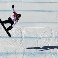 Photo - Canada's Mark McMorris lands from a jump during the men's snowboard slopestyle qualifying at the Rosa Khutor Extreme Park ahead of the 2014 Winter Olympics, Thursday, Feb. 6, 2014, in Krasnaya Polyana, Russia.  (AP Photo/Andy Wong)