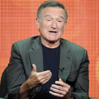 Photo - FILE - In this July 29, 2013 file photo, actor Robin Williams participates in the