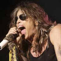 Photo - FILE- In this June 10, 2009 file photo, vocalist  Steven Tyler, of the rock band Aerosmith, performs at the Verizon Wireless Amphitheater in Maryland Heights, Mo. Tyler plans to attend a legislative hearing in Hawaii on Friday, Feb. 8, 2013, on a bill that bears his name and would limit people's freedom to take photos and video of celebrities. (AP Photo/Jeff Roberson, File)
