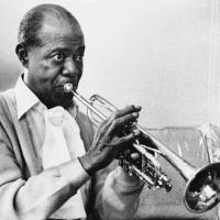 Photo -   FILE -- In a June 21, 1971 file photo jazz great Louis Armstrong practices with his horn at his Corona, New York home on June 21, 1971. A live recording of Louis Armstrong playing his trumpet for one of the last times is being played Friday April 27, 2012 at the National Press Club in Washington where it was created in January 1971. (AP Photo/Eddie Adams, file)