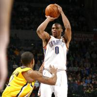 Photo - Oklahoma City's Russell Westbrook (0) shoots over Indian's Earl Watson during the NBA basketball game between the Oklahoma City Thunder and the Indiana Pacers, Saturday, Jan. 9, 2010 at the Ford Center in Oklahoma City. Photo by Sarah Phipps, The Oklahoman ORG XMIT: KOD