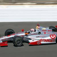 Photo - Tony Kanaan, of Brazil, heads into the first turn on the final day of practice for the Indianapolis 500 IndyCar auto race at the Indianapolis Motor Speedway in Indianapolis, Friday, May 23, 2014. The 98th running of the Indianapolis 500 is Sunday. (AP Photo/Tom Strattman)