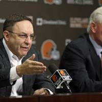 Photo - Cleveland Browns CEO Joe Banner, left, and new owner Jimmy Haslam answer questions during a news-conference at the Browns' NFL football training facility Monday, Dec. 31, 2012, in Berea, Ohio. One day after ending yet another dismal season with a loss in Pittsburgh, Cleveland fired coach Pat Shurmur and general manager Tom Heckert, the first moves in what is expected to be a massive offseason overhaul by Haslam. (AP Photo/Tony Dejak)