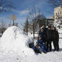 Photo - Sen. Jim Inhofe's daughter, Molly Rapert, far right, and family, Zegita Marie, Jonah, Luke, husband Jimmy, and Jase, built an igloo Saturday in Washington, D.C., with signs poking fun at global warming.  PHOTO PROVIDED BY RAPERT FAMILY     ORG XMIT: 1002122221221262