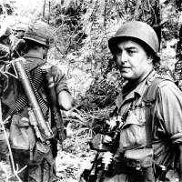 Photo -   FILE - In this undated file photo, Associated Press photographer Horst Faas is shown on assignment with soldiers in South Vietnam. Faas, a prize-winning combat photographer who carved out new standards for covering war with a camera and became one of the world's legendary photojournalists in nearly half a century with The Associated Press, died Thursday May 10, 2012. He was 79. (AP Photo/File)