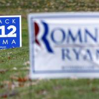 Photo -   Campaign signs for both President Barack Obama, and his challenger, Republican presidential candidate, former Massachusetts Gov. Mitt Romney are seen in yards outside Evans City, Pa., Friday, Nov. 2, 2012. In the final days of the presidential campaign, Romney is making a concerted push into Pennsylvania, aided by outside political groups that are spending millions in last minute ads in the state to help erode Obama's 2008 support. Polling shows Obama holding on to a 4 or 5 percentage point lead over Romney, but the trend has been in Romney's favor. (AP Photo/Keith Srakocic)