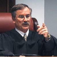 Photo - Oklahoma County District Judge Ray C. Elliott gestures Tuesday from the bench. <strong>Sue Ogrocki - AP</strong>