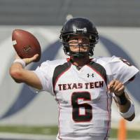 Photo - Texas Tech University quarterback Graham Harrell throws a pass against Rice University during the second quarter of a college football game Saturday, Sept. 15, 2007, in Houston. (AP Photo/David J. Phillip) ORG XMIT: TXDP104
