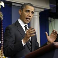 Photo - President Barack Obama gestures as he speaks in the James Brady Press Briefing Room of the White House in Washington, Tuesday, Feb. 5, 2013. The president asked Congress to come up with tens of billions of dollars in short-term spending cuts and tax revenue to put off the automatic across the board cuts that are scheduled to kick in March 1. (AP Photo/Pablo Martinez Monsivais)