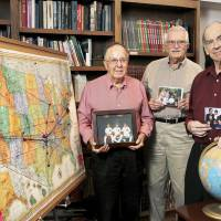 Photo - Three men who participated in a mapping project are, from left, William Rodgers, Darryl Woodson and William Bennett. Push pins and string represent the hometowns of children and grandchildren of residents at the Fountains at Canterbury.  Photo  by Jim Beckel, The Oklahoman.  Jim Beckel - THE OKLAHOMAN