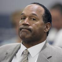 Photo - File-This Monday, Sept. 15, 2008,  file photo shows O.J. Simpson appearing in court  for opening statements on the first day his trial in Las Vegas. Simpson is heading back to the Las Vegas courthouse where he was convicted of leading five men in an armed sports memorabilia heist to ask a judge for a new trial because, he says, the Florida lawyer  botched his defense. (AP Photo/Jae C.Hong,File)