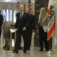 Photo -   Gov. Jerry Brown leaves his office to attend a news conference where he discussed the passage of his tax initiative, Proposition 30, in Sacramento, Calif., Wednesday, Nov. 7, 2012. Brown called the voter approved measure, that will place a temporary increase on the state sales tax and on the wealthy with the proceeds earmarked for education, a