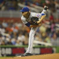 Photo - New York Mets starting pitcher Jacob deGrom throws to the Miami Marlins during the first inning of a baseball game in Miami, Saturday, June 21, 2014. (AP Photo/J Pat Carter)