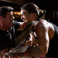 Photo - This film image released by Warner Bros. Pictures shows Sylvester Stallone, left, and Jason Momoa in a scene from