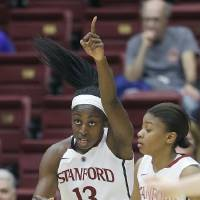 Photo - Stanford forward Chiney Ogwumike (13) celebrates after scoring against USC during the first half of an NCAA college basketball game in Stanford, Calif., Monday, Jan. 27, 2014. Stanford won 86-59. (AP Photo/Jeff Chiu)