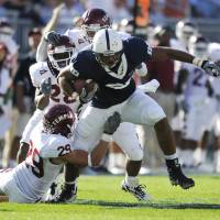 Photo -   In this photo taken Sept. 25, 2010, Penn State's Garry Gilliam fights for extra yards in the second quarter of an NCAA college football game agains Temple in State College, Pa. After two knee injuries, tight end Garry Gilliam is going from the sidelines to a possibly a feature player of the offense in coach Bill O'Brien's new system. Gilliam is one of three key Nittany Lions trying to bounce back from knee problems this spring. (AP Photo/Centre Daily Times (Knight Ridder), Nabil K. Mark ) MANDATORY CREDIT; MAGS OUT