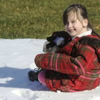 Photo - In this Feb. 10, 2013 photo, Kelly Guarna's 5-year-old daughter Madison pose for a portrait in Mount Carmel, Pa. The kindergartener was suspended from school for making a