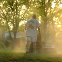 Photo - FILE - In a Monday, April 5, 2010, file photo, Shane Nantz kicks up a cloud of pollen as he mows the front yard of his west Charlotte, N.C., home. Seasonal allergy sufferers can try newly FDA-approved types of immnotherapy, once-a-day tablets containing freeze-dried grass extract that dissolve quickly under the tongue, steadily lessening the excessive immune reaction much like the shots. (AP Photo/The Charlotte Observer, Todd Sumlin, File)