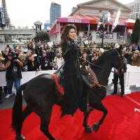 Photo -   Shania Twain makes her official arrival on horseback at Caesars Palace in Las Vegas on Wednesday, Nov. 14, 2012. Twain is set to begin a two-year residency at the Colosseum with her show