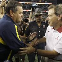 Photo -   Michigan head coach Brady Hoke, left, and Alabama head coach Nick Saban shake hands after their NCAA college football game at Cowboys Stadium in Arlington, Texas, Saturday, Sept. 1, 2012. Alabama won 41-14. (AP Photo/LM Otero)