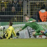 Photo - Dortmund's Julian Schieber, left, scores the opening goal against Manchester City goalkeeper Joe Hart, center, and Vincent Kompany, right, during the Champions League Group D soccer match between Borussia Dortmund and Manchester City in Dortmund, Tuesday, Dec. 4, 2012. (AP Photo/Martin Meissner)