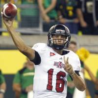 Photo -   Arkansas State quarterback Ryan Aplin throws during the first half of their NCAA college football game against Oregon in Eugene, Ore., Saturday, Sept. 1, 2012. (AP Photo/Don Ryan)