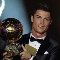 Photo - Cristiano Ronaldo of Portugal is awarded the prize for the FIFA Men's soccer player of the year 2013 at the FIFA Ballon d'Or 2013 gala at the Kongresshaus in Zurich, Switzerland, Monday, Jan. 13, 2014. (AP Photo/Keystone, Steffen Schmidt)