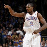 Photo - CELEBRATION: Oklahoma City's Serge Ibaka (9) celebrates after a basket during an NBA basketball game between the Oklahoma City Thunder and the Toronto Raptors at Chesapeake Energy Arena in Oklahoma City, Tuesday, Nov. 6, 2012.  Tuesday, Nov. 6, 2012. Oklahoma City won 108-88. Photo by Bryan Terry, The Oklahoman