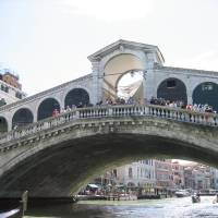 Photo -  Shops line both sides of the Rialto Bridge over the Grand Canal in Venice.