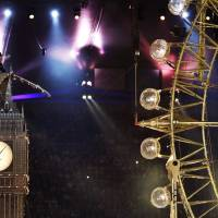Photo -   Actor Timothy Spall portrays Winston Churchill as he delivers a speech from atop a representation of St. Stephens' Tower during the Closing Ceremony at the 2012 Summer Olympics, Sunday, Aug. 12, 2012, in London. (AP Photo/Matt Dunham)