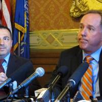 Photo - Wisconsin Republican Assembly Speaker Robin Vos, right, and Majority Leader Scott Suder answer questions at a news conference prior to the Assembly debating the state budget on Tuesday, June 18, 2013, in Madison, Wis. (AP Photo/Scott Bauer)