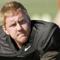 Photo - OKLAHOMA STATE UNIVERSITY / OSU / COLLEGE FOOTBALL: Oklahoma State's Brandon Weeden stretches during practice in Scottsdale, Ariz. Saturday, Dec. 31, 2011. Oklahoma State will play Stanford in the Fiesta Bowl on Monday, January 2, 2012. Photo by Bryan Terry, The Oklahoman