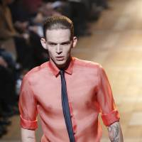 Photo - A model wears a creation for Lanvin fall-winter 2013/2014 men's fashion collection, presented in Paris, Sunday, Jan.20, 2013. (AP Photo/Christophe Ena)