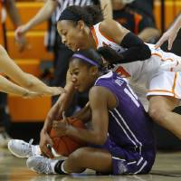 Photo - Oklahoma State's Tiffany Bias (3) reaches for the ball over TCU's Zahna Medley (14) during a women's college basketball game between Oklahoma State University and TCU at Gallagher-Iba Arena in Stillwater, Okla., Tuesday, Feb. 5, 2013. Oklahoma State won 76-59.  Photo by Bryan Terry, The Oklahoman