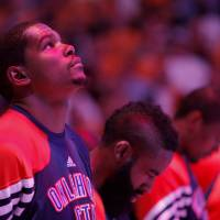 Photo - Oklahoma City's Kevin Durant (35) looks up during national anthem during Game 3 in the second round of the NBA basketball playoffs between the L.A. Lakers and the Oklahoma City Thunder at the Staples Center in Los Angeles, Friday, May 18, 2012. Photo by Nate Billings, The Oklahoman
