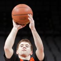 Photo - Keiton Page and the Cowboys open Big 12 Tournament play today against Iowa State. PHOTO BY CHRIS LANDSBERGER, the Oklahoman